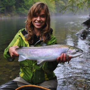 Kitty holding the first steelhead of the trip. Summer steelhead in the fall quite often get these rainbow/iridescent colours to them.