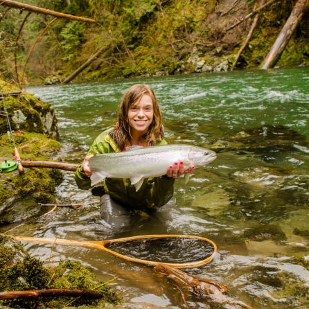 Kitty in a stunning canyon setting with a prime steelhead doe. This fish marked off her 4th river of the year.